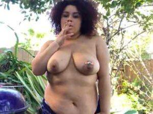 BBW Ebony Smoking Topless Outdoors